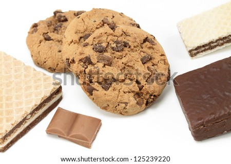 Chocolate cookies and wafers on white background - stock photo
