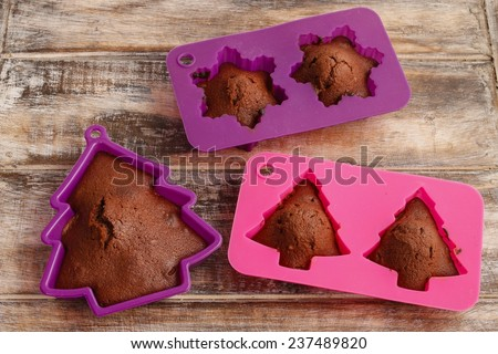 Chocolate cookies in silicone molds - stock photo