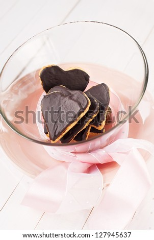 Chocolate Cookies in the Shape of Heart at Valentine's Day with Pink Ribbon
