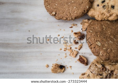 Chocolate cookies on wooden table with copyspace - stock photo