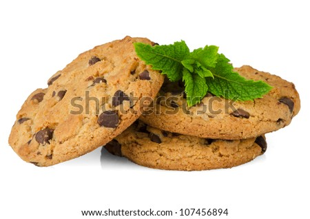 Chocolate cookies with mint leaves isolated on white background. - stock photo