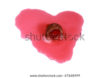 Chocolate covered Cordial cherries lay in a red heart shape of maraschino juice isolated on white with room for your valentines day text - stock photo
