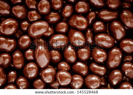 Chocolate covered peanuts for Backgrounds or Texture. Macro studio shot. - stock photo
