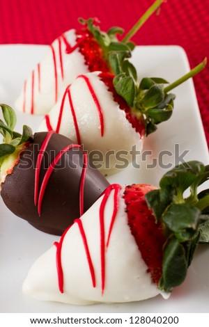chocolate covered strawberries with dark and white chocolate - stock photo