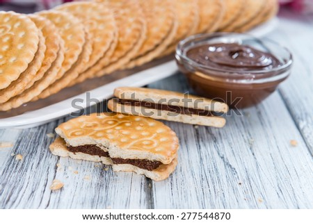 Chocolate Cream Cookies (close-up shot) on wooden background - stock photo