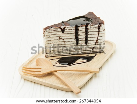 chocolate crepe cake on wood dish - stock photo