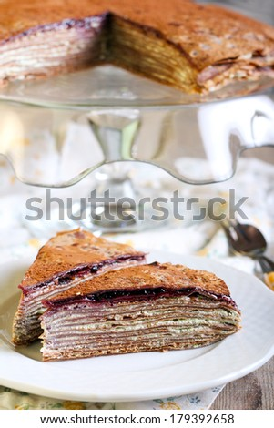 Chocolate crepe cake with cream and jam