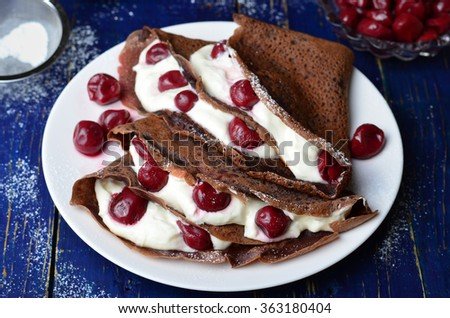 Chocolate Crepes with Cherry and Whipped Cream - stock photo