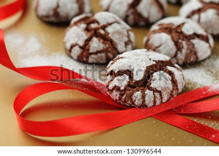 Chocolate crinkles cookies  on a golden table - stock photo