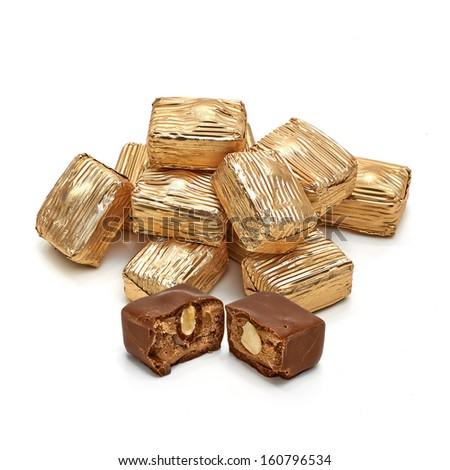 Chocolate cubes on white background - stock photo