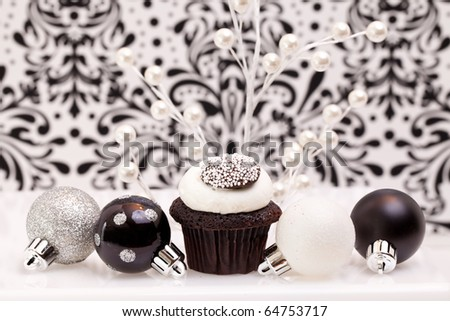 Chocolate Cupcake Against An Elegant Background With Christmas Ornaments
