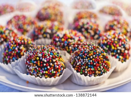 chocolate cupcake decorated with colorful sweet beads - stock photo