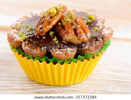 Chocolate Cupcake on a wooden table. Selective focus - stock photo