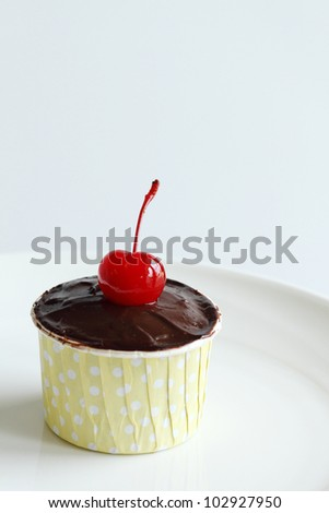 chocolate cupcake with bear - stock photo