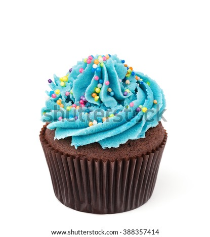 chocolate cupcake with blue buttercream isolated on white