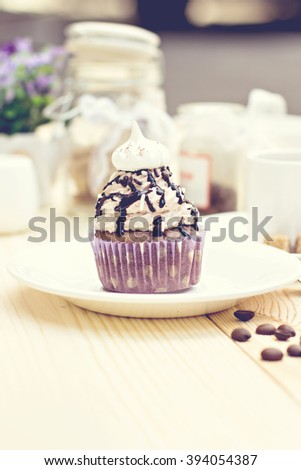 Chocolate Cupcake with chocolate frosting on the table