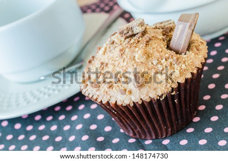 Chocolate cupcake with chocolate stick on top - stock photo