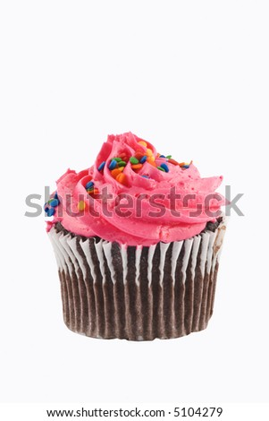 Chocolate cupcake with colored frosting and sprinkles on white background