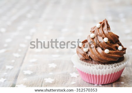 chocolate cupcake with colorful sprinkles. the toning. selective focus.