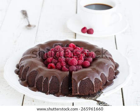 Chocolate cupcake with raspberry and chocolate glaze.selective focus - stock photo