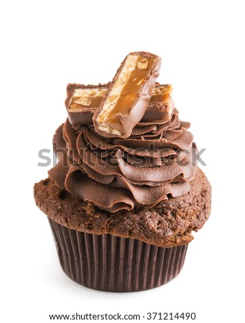 chocolate cupcake with slices of choco bar isolated on white - stock photo