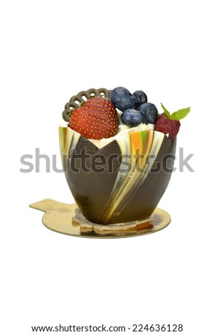 Chocolate cupcake with strawberry, blueberry and  raspberry isolated  on white background - stock photo
