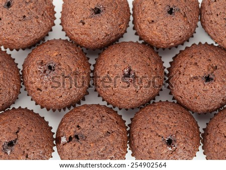 chocolate cupcakes muffin as background - stock photo