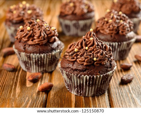 Chocolate cupcakes on a brown table