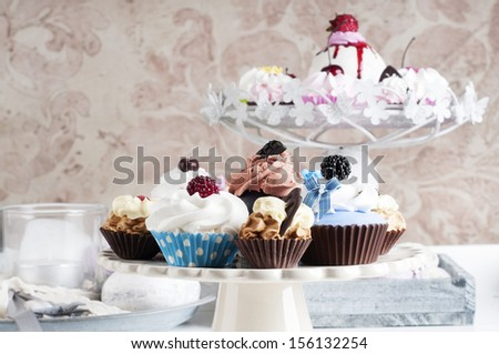 Chocolate cupcakes on a cake stand - stock photo