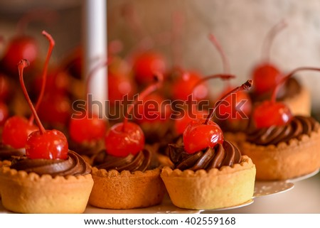 Chocolate cupcakes with cherry on top - stock photo