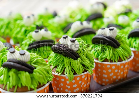 Chocolate cupcakes with green frosting - stock photo