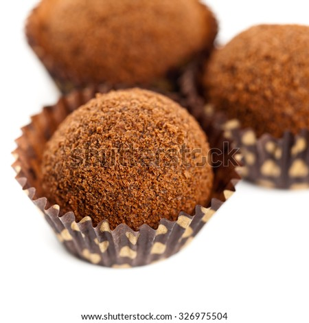 Chocolate Deserts. Chocolate Cocoa Honey Balls on white background. Macro with extremely shallow dof. Selective focus. - stock photo
