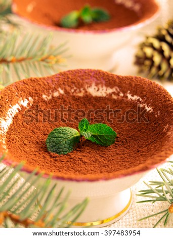 Chocolate dessert with cocoa and Mint. Christmas decorations