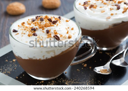chocolate dessert with cream and amaretti in cups, close-up - stock photo