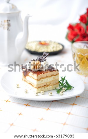 Chocolate dessert with tea, red roses and napkin - stock photo