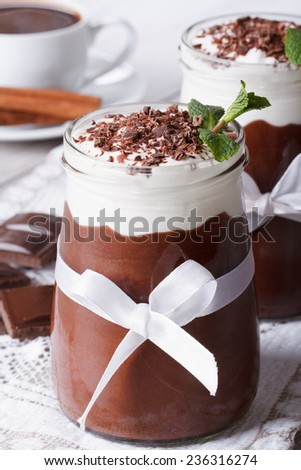chocolate dessert with whipped cream and coffee on the table. closeup vertical  - stock photo