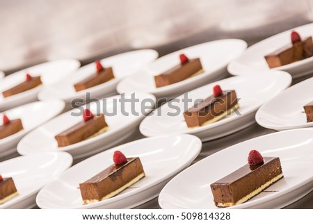 Chocolate desserts plated in commercial kitchen