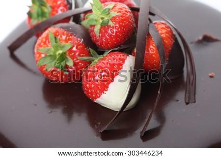Chocolate dipped strawberries at dessert bar - stock photo