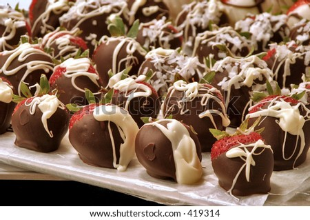 Chocolate Dipped Strawberries on a sheet of wax paper - stock photo