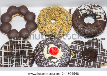 Chocolate donuts in the white box. - stock photo