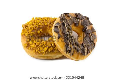 chocolate doughnut with caramel doughnut on white background - stock photo