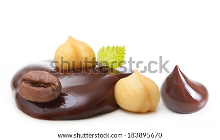 Chocolate drop with nuts and coffee grain on a white background - stock photo