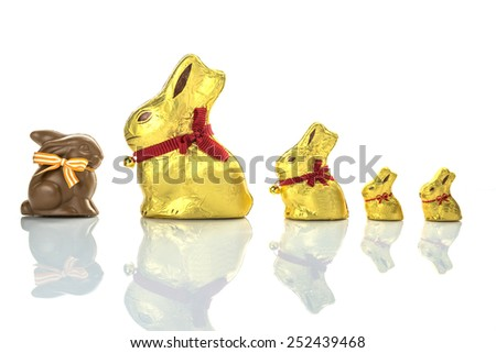 Chocolate Easter Bunnies lined up on white background - stock photo