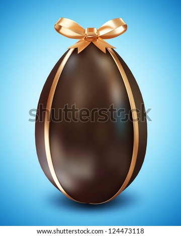 Chocolate Easter Egg with Golden Bow on blue background