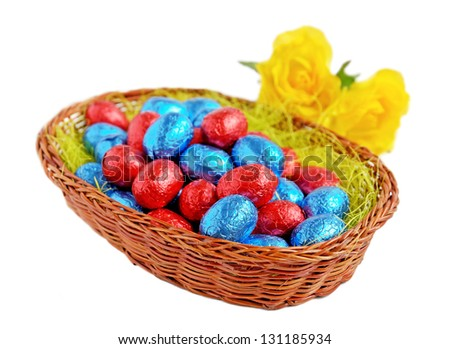 Chocolate easter eggs in a wicker basket, selective focus.