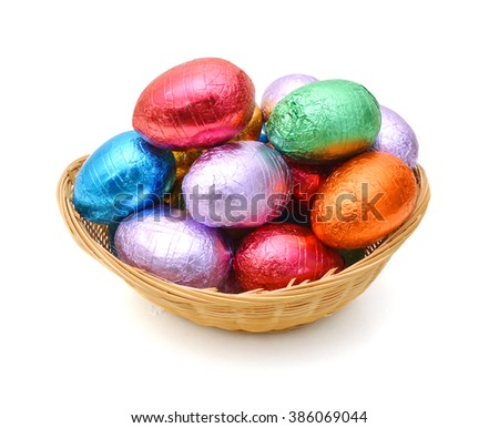 Chocolate easter eggs in basket on white background