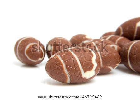 chocolate easter eggs in closeup over white background