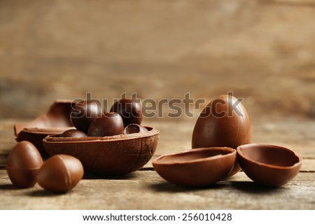Chocolate Easter Eggs on wooden background - stock photo