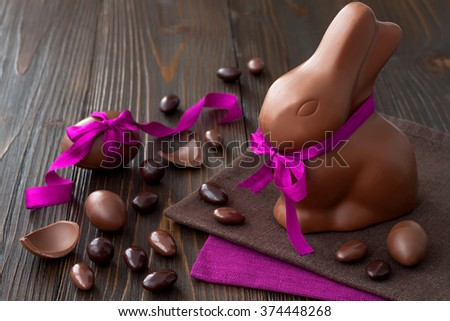 Chocolate Easter eggs over rustic wooden background. Copy space - stock photo