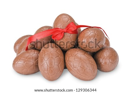 Chocolate easter eggs with a red ribbon isolated on white - stock photo
